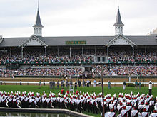 220px-University_of_Louisville_marching_band,_Churchill_Downs_Twin_Spires