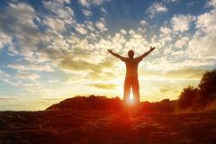 worship-praise-silhouette-man-hands-raised-sunset-concept-religion-prayer-42264053