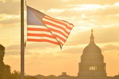 united-states-capitol-building-us-flag-silhouette-sunrise-washington-dc-32495255